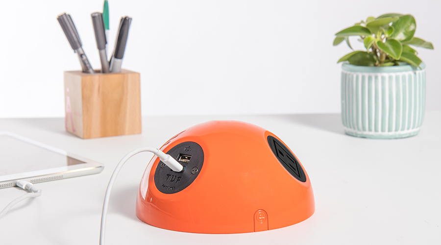 bright orange power unit with nema socket and usb
