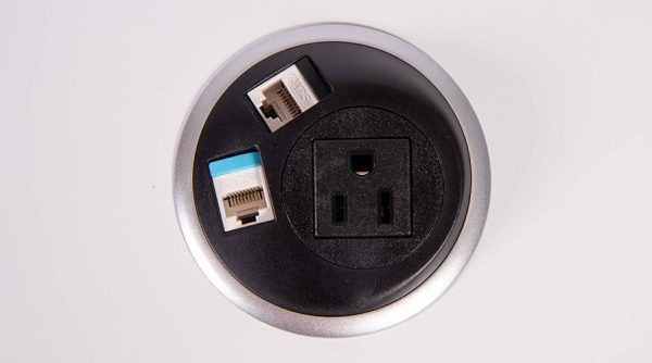 in surface black and gray power unit with nema socket and data. mount in surfaces in table, workspace, work surface