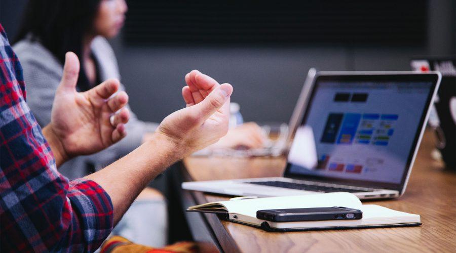 team-meeting-laptop-phone-notebook