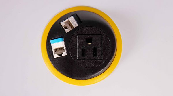 in surface black and yellow power unit with nema socket and data. mount in surfaces in table, workspace, work surface